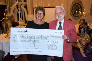 "Julie Cawood presents cheque for £1000 to founding member Mr Arthur Benbow after ""Dragon's Den Triumph"""